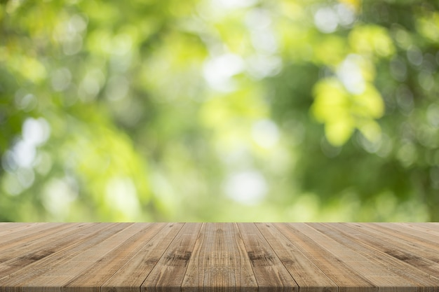 dessus de table en bois sur fond flou vert nature pour le montage de vos produits t l charger. Black Bedroom Furniture Sets. Home Design Ideas