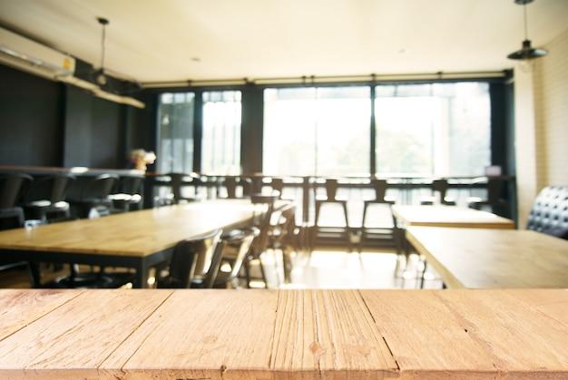 https://image.freepik.com/photos-libre/vider-la-table-en-bois-sombre-en-face-d-39-un-fond-abime-en-flou-de-l-39-interieur-du-cafe-et-du-cafe-peut-etre-utilise-pour-l-39-affichage-ou-le-montage-de-vos-produits_1715-978.jpg