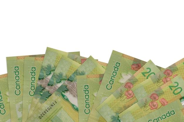 20 banconote in dollari canadesi si trovano sul lato inferiore dello schermo isolato su bianco Foto Premium