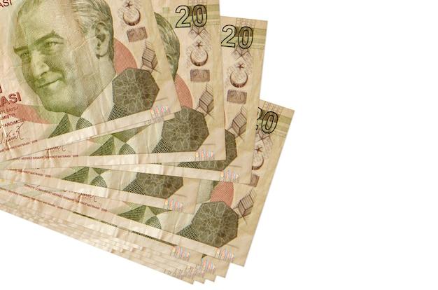 20 banconote in lire turche si trovano in un piccolo mazzo o pacco isolato su bianco. concetto di cambio valuta e affari Foto Premium