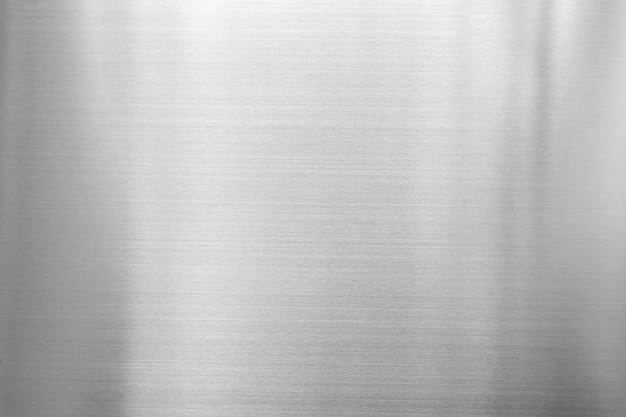 Sfondo astratto dalla placca di metallo argento. materiale di superficie lucido. Foto Premium