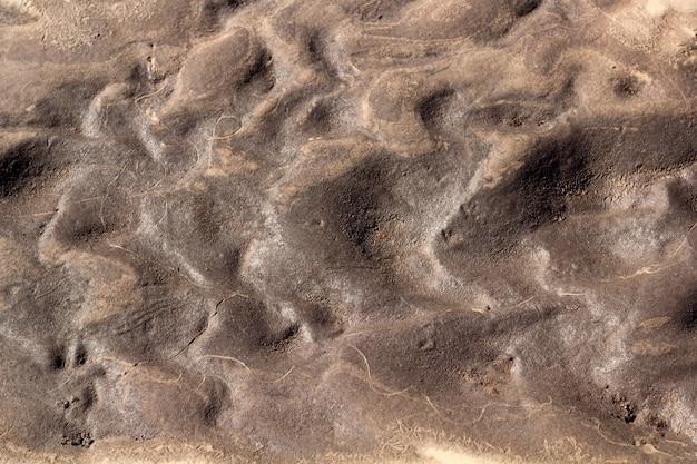 Struttura astratta della priorità bassa della sabbia e dell'argilla bagnate Foto Premium