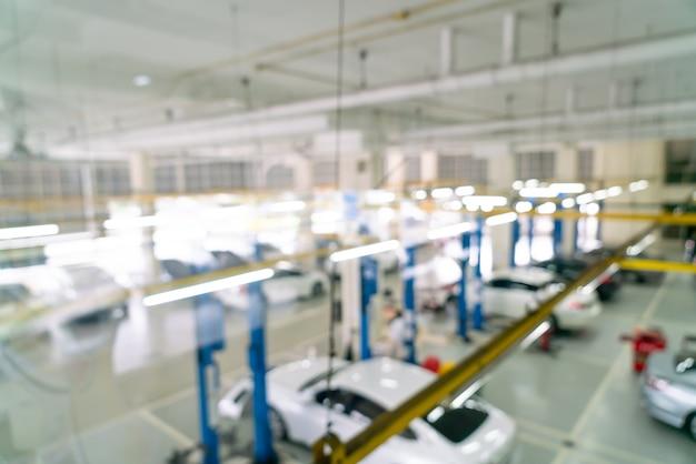 Sfocatura astratta servizio auto garage per lo sfondo Foto Premium