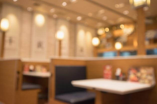 Il ristorante sfocato astratto del caffè con il bokeh accende il fondo defocused Foto Premium