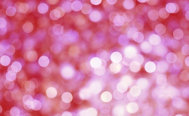 Estratto del fondo pastello del bokeh. luce bokeh. luci spot sfocatura scintillante su sfondo astratto multicolore Foto Premium