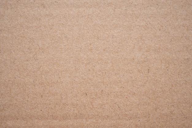 Fondo di struttura della carta del cartone riciclato marrone astratto Foto Premium