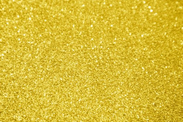 Fondo astratto della luce del bokeh della scintilla di scintillio dell'oro Foto Premium