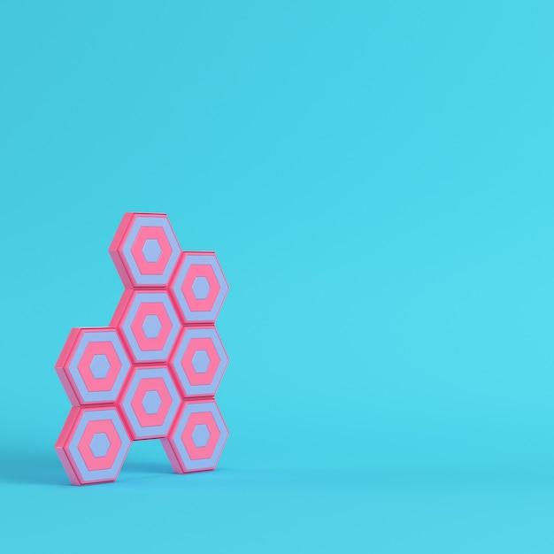 Esagoni astratti su sfondo blu brillante in colori pastello Foto Premium
