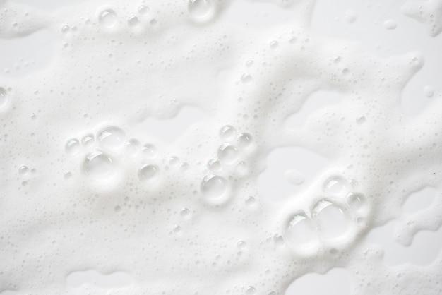 Struttura bianca schiuma insaponata astratta. shampoo schiuma con bolle Foto Premium
