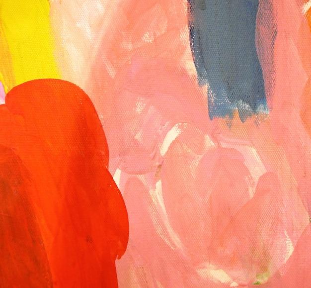 Colori acrilici rosa e rossi dipingono su tela. sfondo astratto. Foto Premium