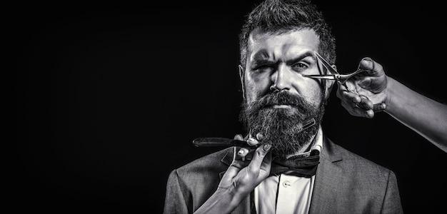 Forbici da barbiere e rasoio a mano libera, barbiere. Foto Premium