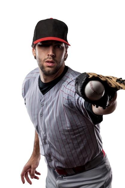 Giocatore di baseball in uniforme rossa ,. Foto Premium