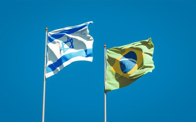 Bandiere di stato nazionale belle di israele e brasile insieme sul cielo blu Foto Premium