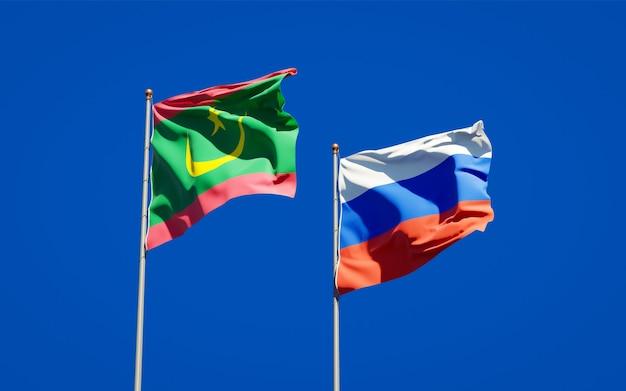 Belle bandiere di stato nazionali della mauritania e della russia insieme sul cielo blu. grafica 3d Foto Premium