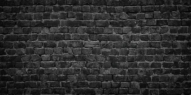 Parete nera di struttura del fondo dei mattoni Foto Premium