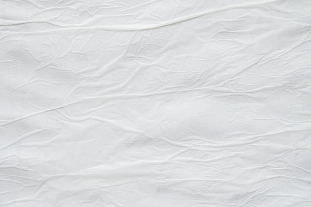 Vuoto bianco sgualcito sgualcito carta strappata poster texture di sfondo di superficie Foto Premium