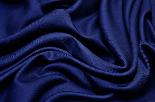 Priorità bassa di struttura del tessuto blu Foto Premium