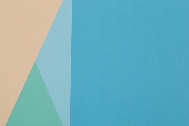 Sfondo blu, verde, giallo, la carta colorata si divide geometricamente in zone Foto Premium