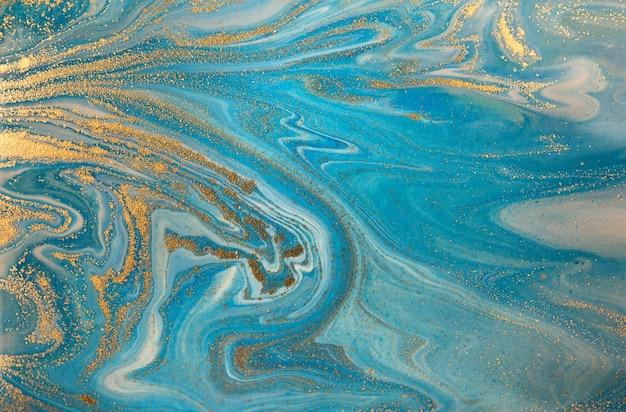 Motivo a onde blu con strati di paillettes dorate. Foto Premium