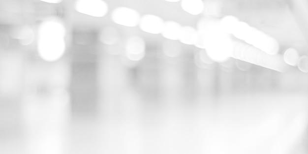 Priorità bassa in bianco e nero vaga: sfocatura ufficio con bokeh sfondo chiaro Foto Premium