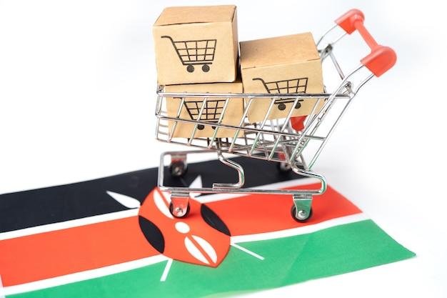 Scatola con l'icona del carrello e la bandiera del kenya, import export shopping online o ecommerce finance delivery service store spedizione del prodotto, commercio, concetto di fornitore. Foto Premium