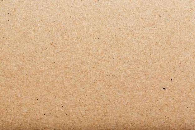 Trama di cartone marrone di una pagina vuota. come sfondo Foto Premium