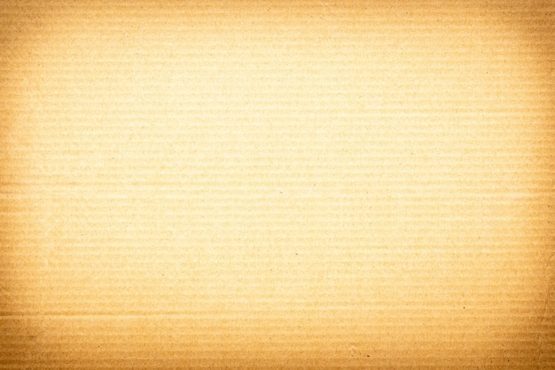 Fondo di struttura di carta marrone o superficie di cartone da una scatola di carta per l'imballaggio. Foto Premium