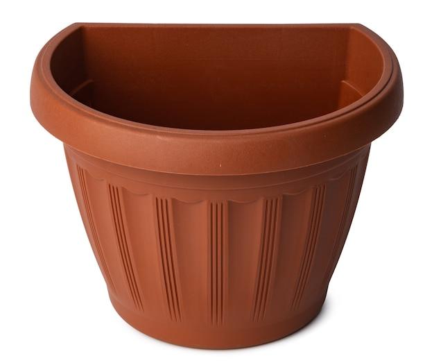 Vaso da fiori in plastica marrone isolato su bianco Foto Premium