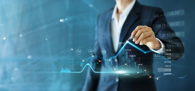 Grafico di crescita di tiraggio dell'uomo d'affari e progresso dell'affare e dell'analisi finanziario. Foto Premium