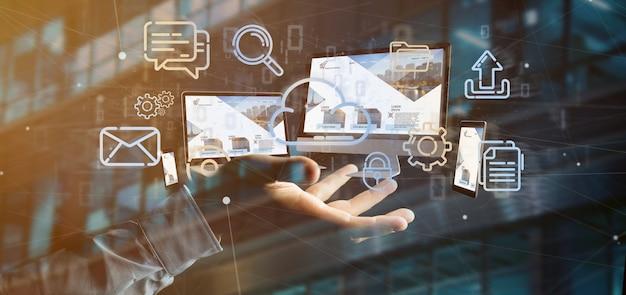 Dispositivi della tenuta dell'uomo d'affari collegati ad una rappresentazione della rete multimediale 3d della nuvola Foto Premium
