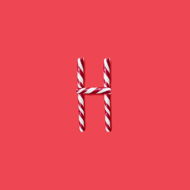 Carattere di caramelle e zucchero. lettera h Foto Premium