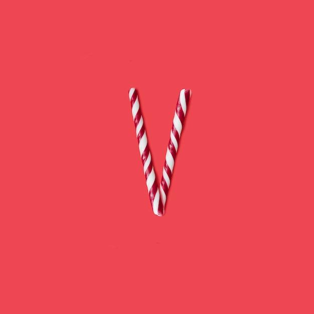 Carattere di caramelle e zucchero. lettera v Foto Premium