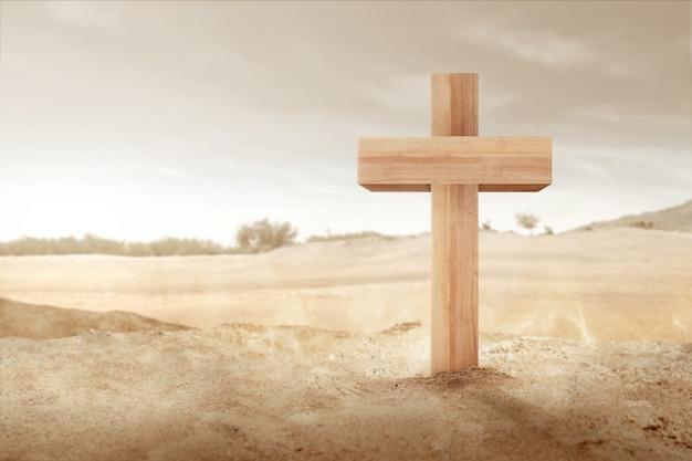 Croce cristiana sulla sabbia Foto Premium