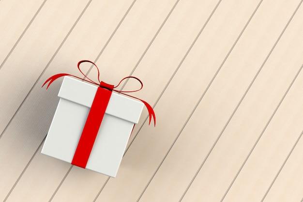 Natale e capodanno, contenitore di regalo bianco rosso isolato sul bordo di legno, rappresentazione 3d Foto Premium