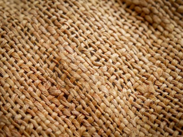 Chiuda in su della priorità bassa marrone di struttura della tela di sacco. focalizzazione morbida Foto Premium