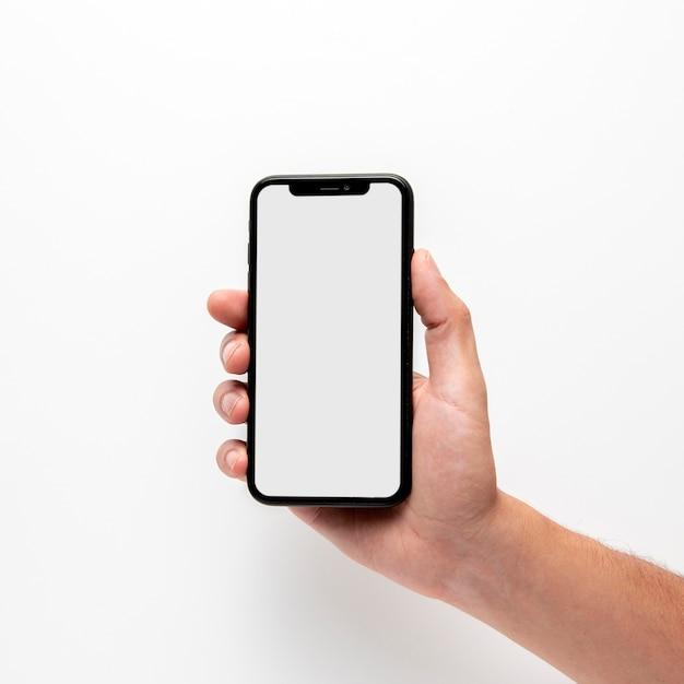 Telefono della holding della mano del primo piano Foto Premium