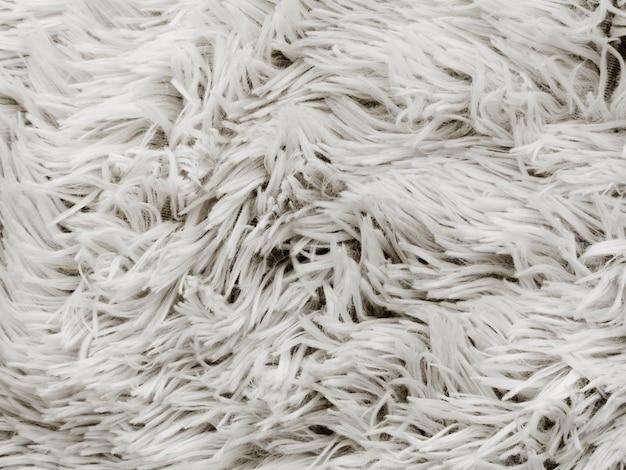 Close-up di morbido tappeto bianco sullo sfondo Foto Premium