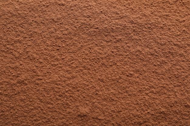 Cacao in polvere strutturato, alto vicino e spazio per testo Foto Premium