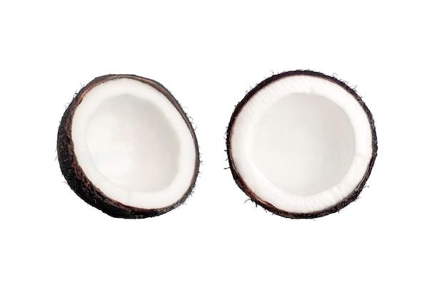 Noci di cocco su uno sfondo blu isolare. noce di cocco il concetto minimo. Foto Premium