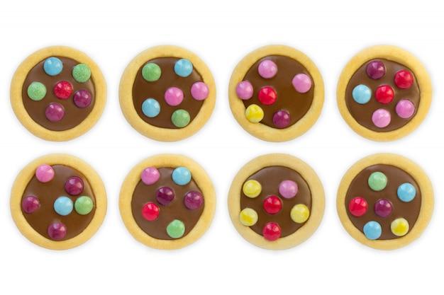 Glassa variopinta dei biscotti, fondo bianco isolato Foto Premium