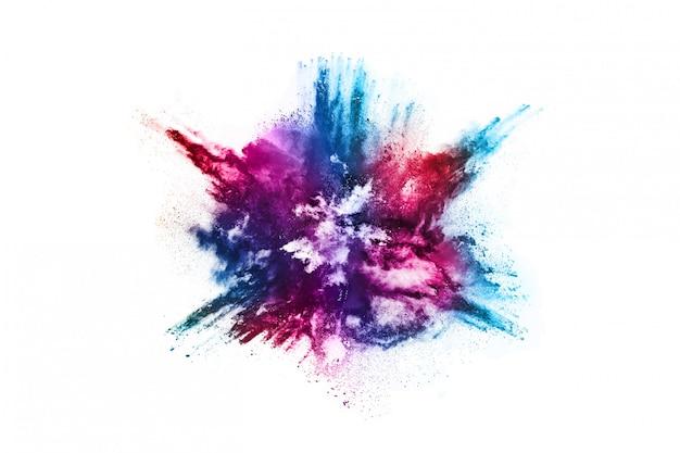 Esplosione di polvere colorata su sfondo bianco Foto Premium