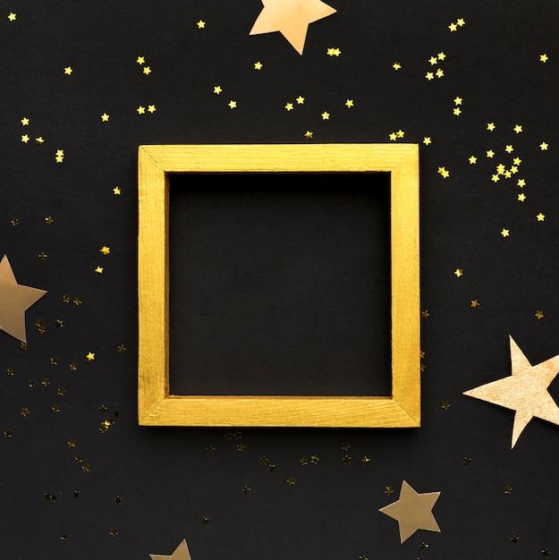 Confetti e cornice dorata Foto Premium
