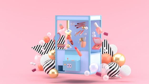 Macchina cosmetica del collettore in mezzo delle palle variopinte su uno spazio rosa Foto Premium
