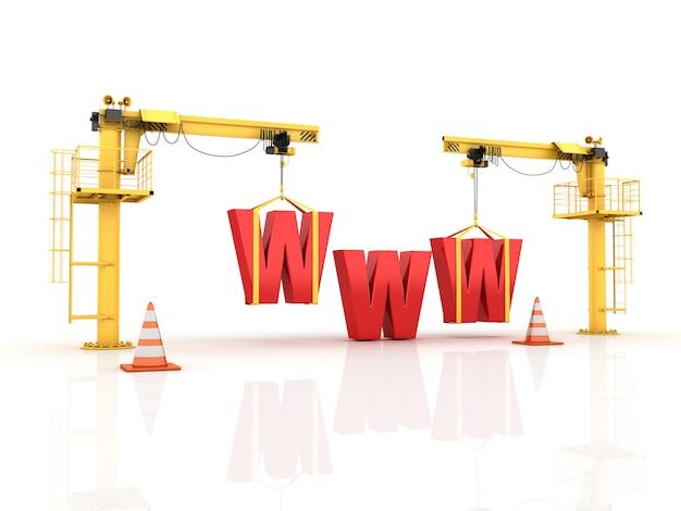 Gru che costruiscono le lettere del www Foto Premium