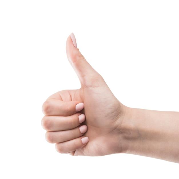 Ritaglia la mano gesticolando pollice in su Foto Premium
