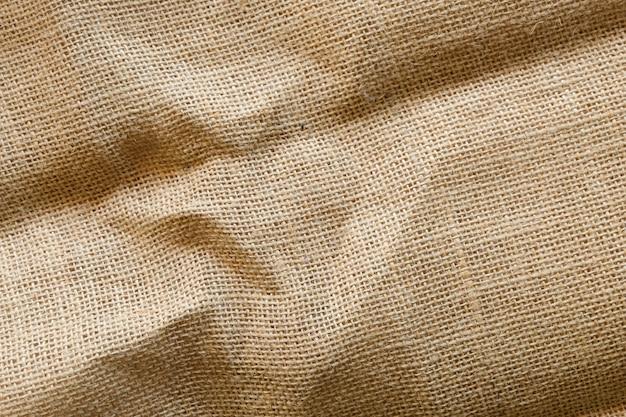Tela sporca trama di sfondo, trama di tessuto di cotone marrone, tela Foto Premium