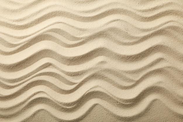 Sabbia di mare asciutta con onde. estate. vacanza Foto Premium