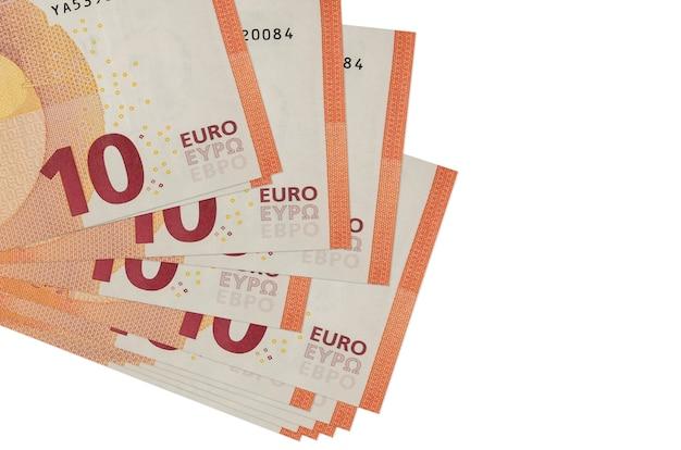 Banconote in euro si trova in un piccolo mazzo o pacchetto isolato sul concetto bianco Foto Premium