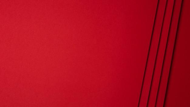 Composizione piana laica del fondo rosso degli strati di carta Foto Premium