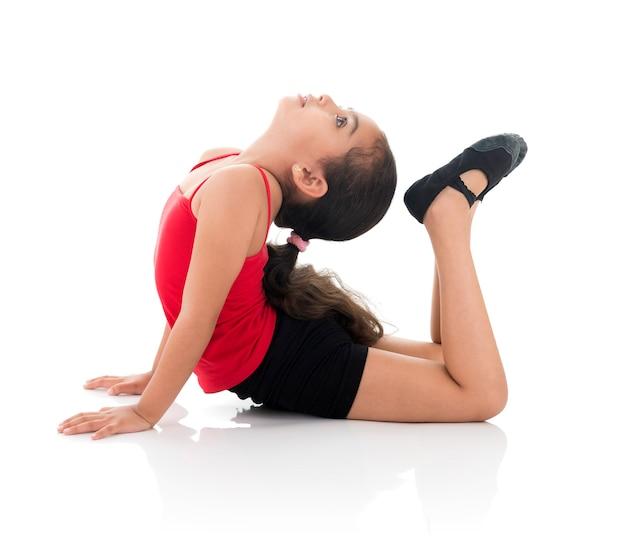 Flessibile giovane ragazza ginnastica Foto Premium